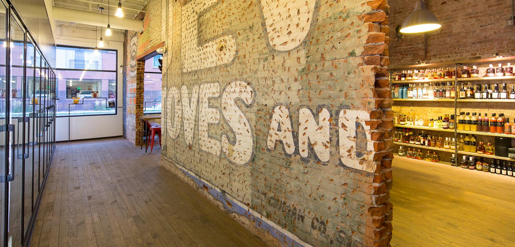 Hugo's Colorado Beer and Spirits coolers and brick wall